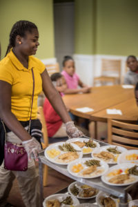 April 1, 2015 - Atlanta, Georgia, United States -  Childern, parents, cooks and administrators at The Study Hall yesterday for the Atlanta Community Food Bank.